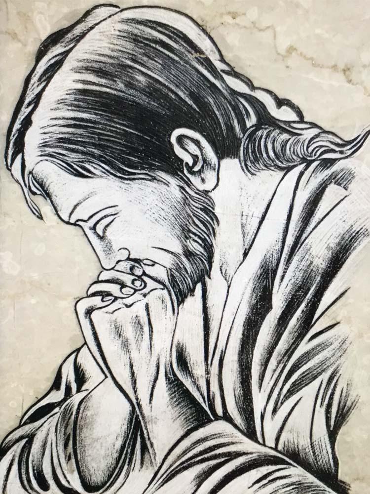 Cristo in preghiera graffiato e colorato