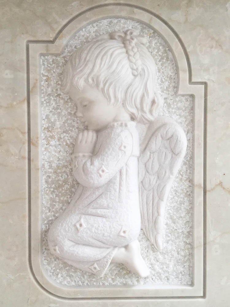 Angel in low relief