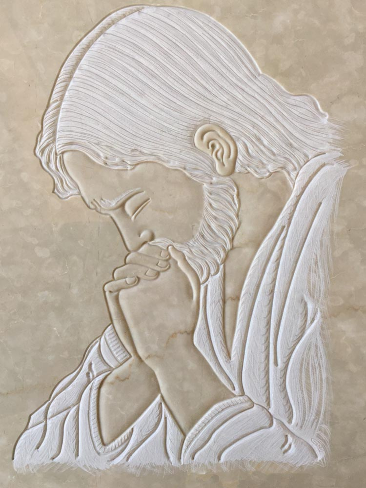 Christ in prayer in low relief