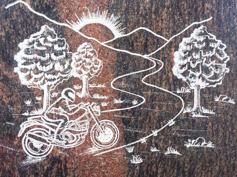 Custom works in marble or granite – Motorcycle engraving with landscape