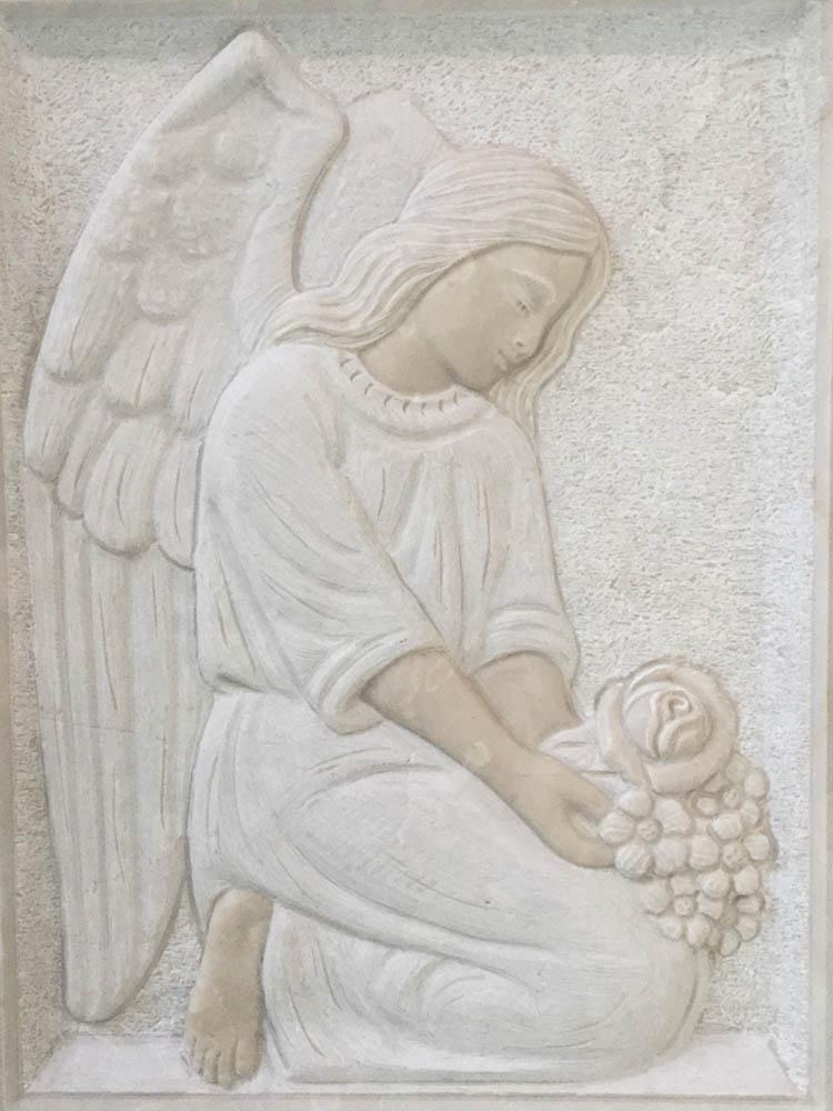 Low relief angel kneeling