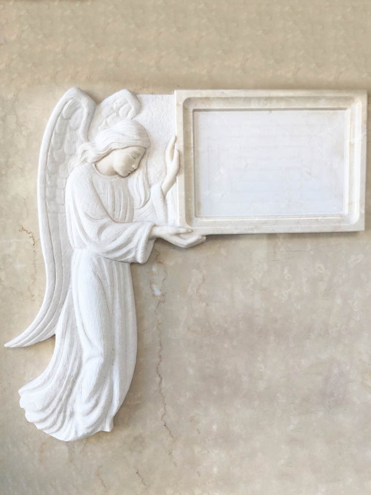 Low relief angel with photo
