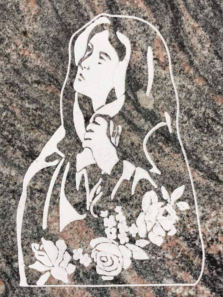 Madonna engraved with flowers
