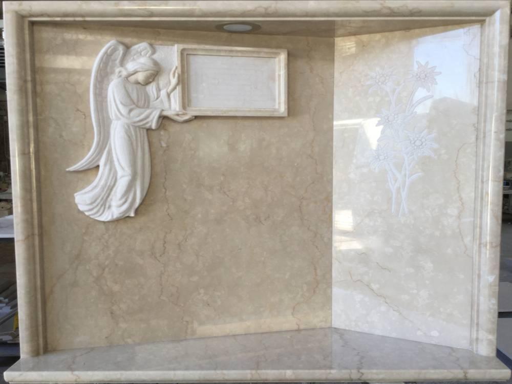 Headstone with angel holding photo cornice