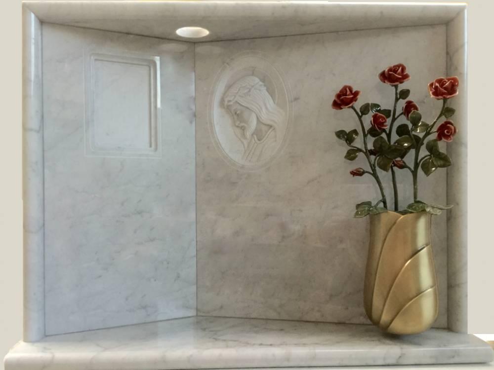 Carrara headstone with bronze decoration