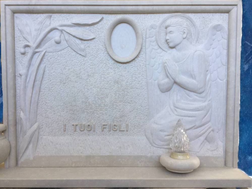 Headstone with praying angel and palm tree